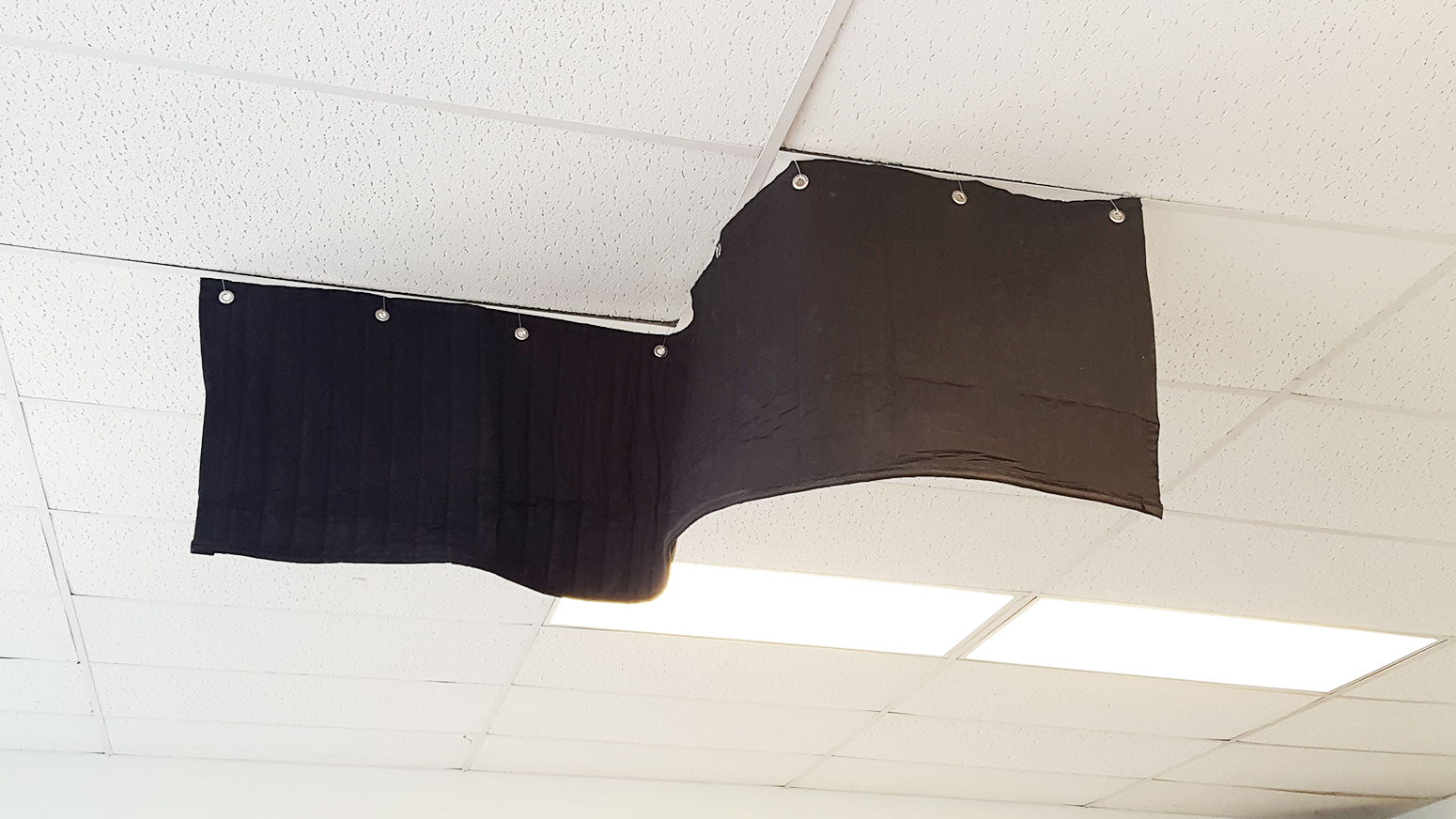 Ceiling sound baffle blanket for sound absorption